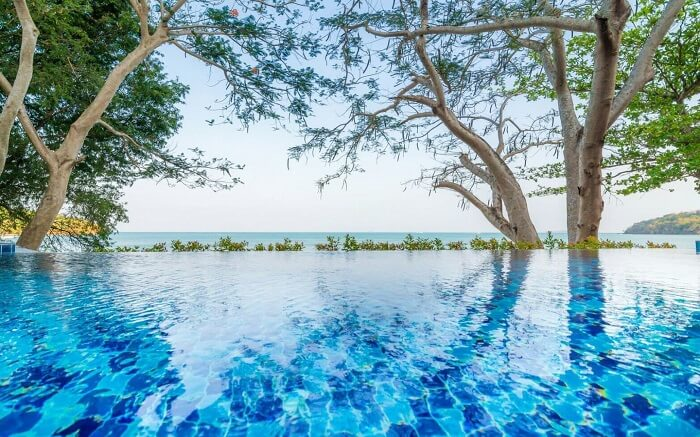 an infinity pool at Koh Sirey Beachfront Pool Villa