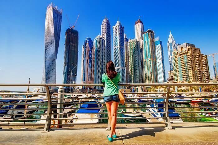 woman looking at dubai skyline
