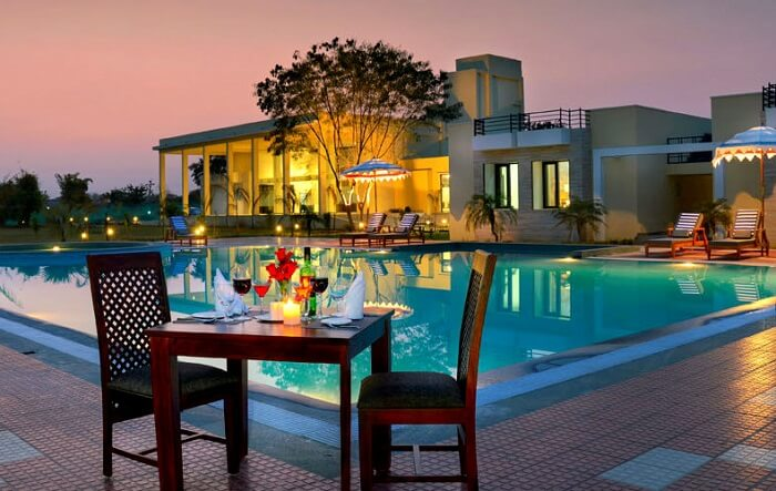 fancy table near pool in juble vilas