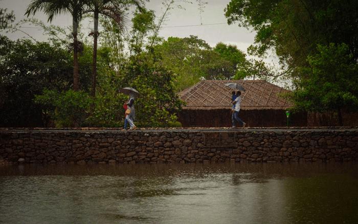 people walking by Saj Vagamon Hideout