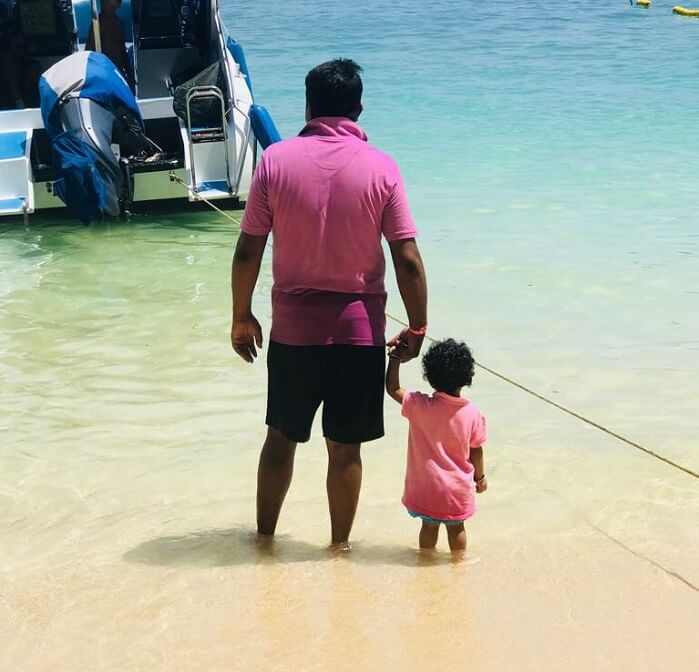 dad and kid on the beach