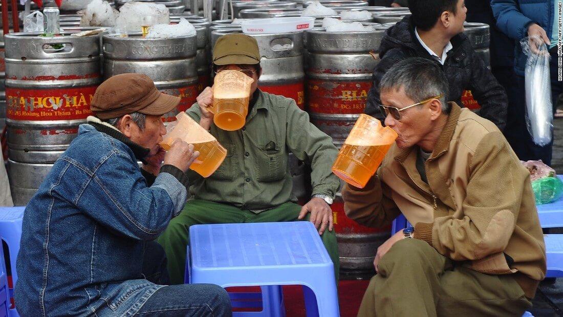 Men enjoying local Beer 'BiaHoi' in Ho Chi Minh