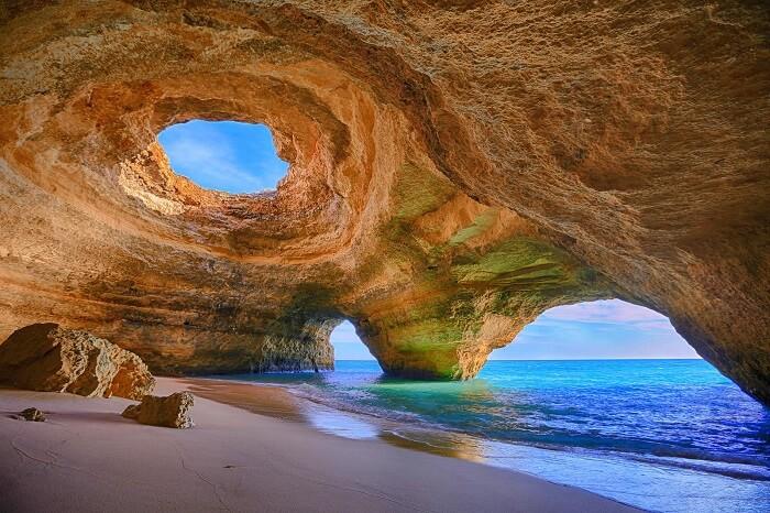 Explore hidden cave beaches in Algarve portugal
