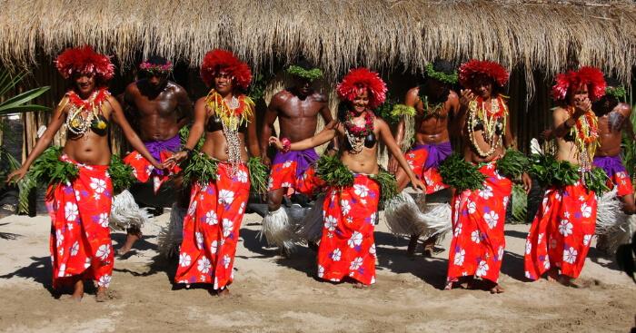 Fijian dancing wearing traditional clothes