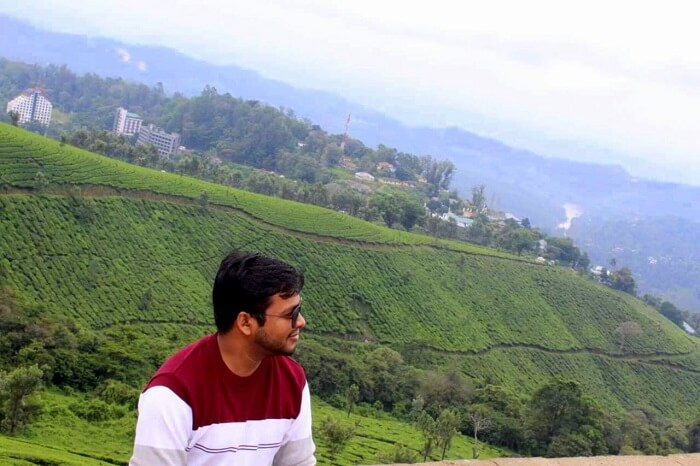 man looking at nature's beauty in munnar