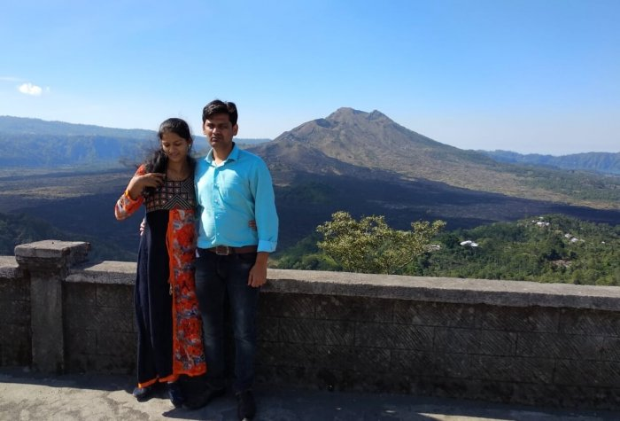couple standing against volcano in bali