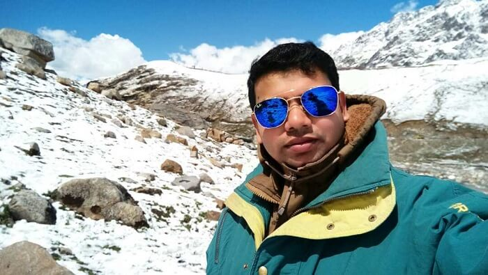 man clicking picture amidst the snow