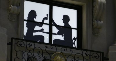 Couple dining silhouette in Macau