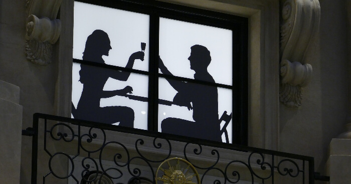 Couple dining silhouette in Macau