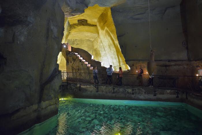 Tourists exploring Naples Underground, Naples, Italy