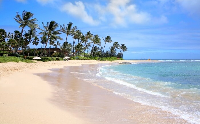 Poipu beach with creamy sand and blue waters