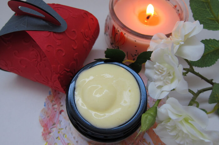 Skin Care cream with scented candles and fowers