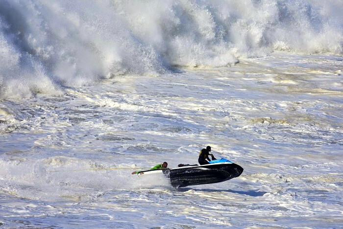 Surf 100 feet high waves in Nazare portugal
