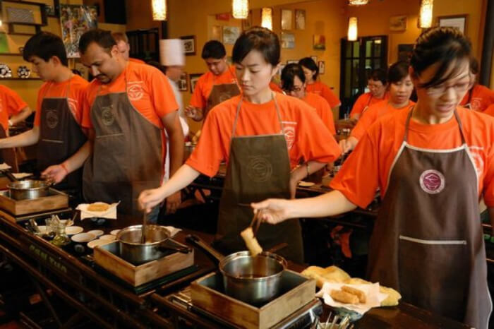 People getting cooking classes at the Vietnamese Cookery Centre in Ho Chi Minh