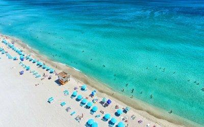 a gorgeous blue beach with blue sundecks