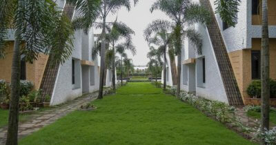 a lush lawn of a Belgaum resort