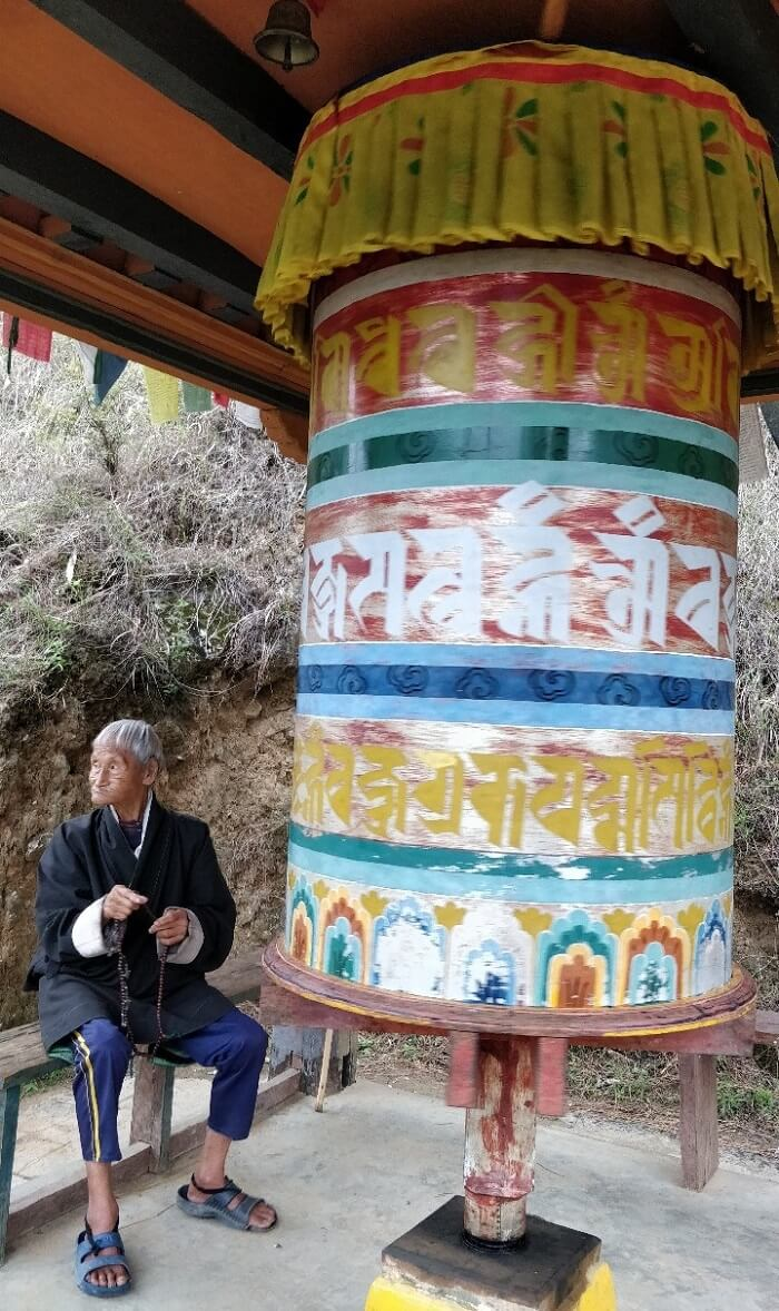 rohit bhutan family trip travelogue old man prayer wheel