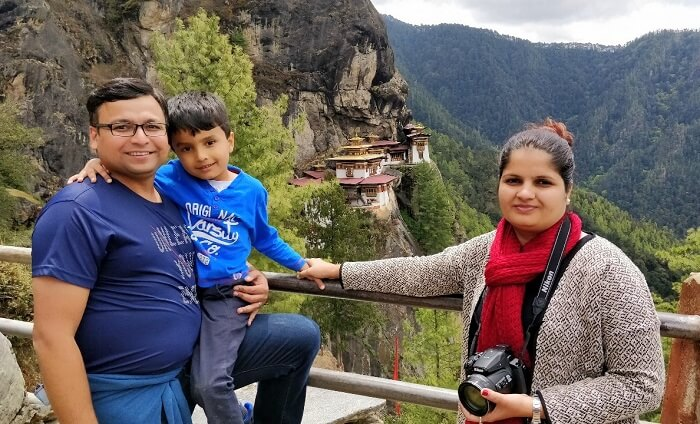 rohit bhutan family trip travelogue posing before tigers nest