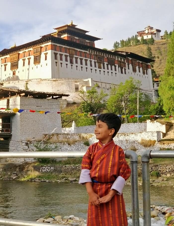 rohit bhutan family trip travelogue son in traditional dress
