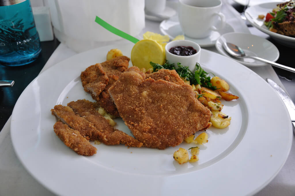 ummy fried delight and is served with a side of fried potatoes