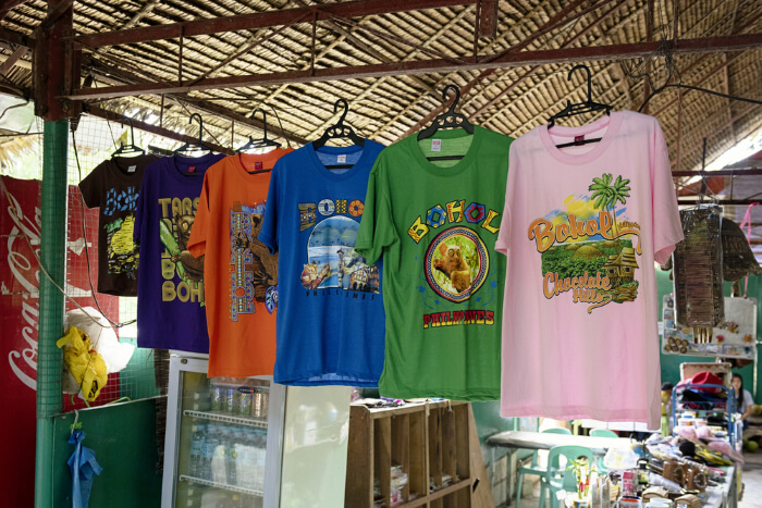 Tshirts hanging for sale in a market in Bohol, Philippines