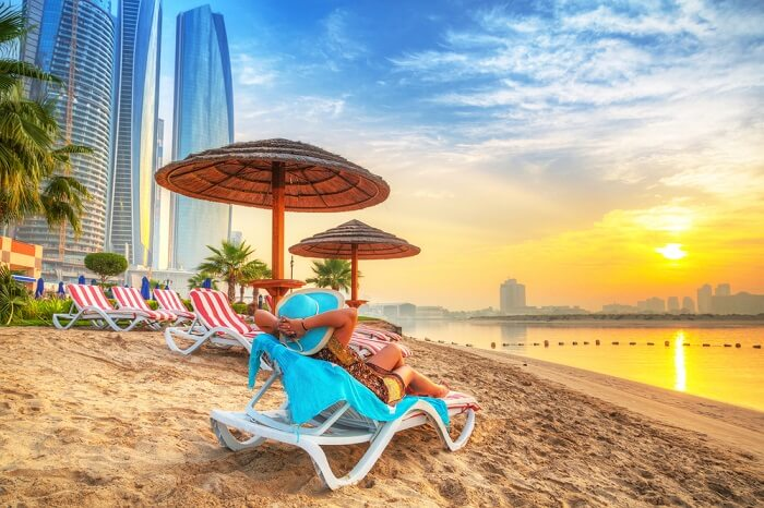 woman relaxing on abu dhabi beach
