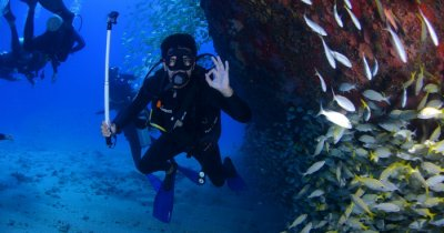 A diver showing OK sign under water