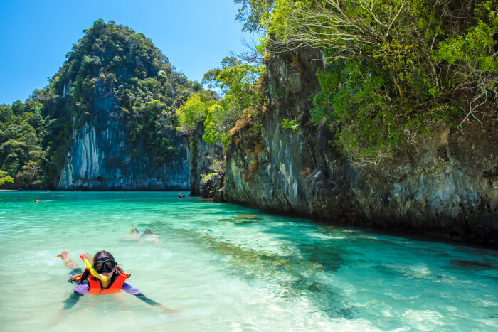A kid snorkeling in Hong Island in Thailand