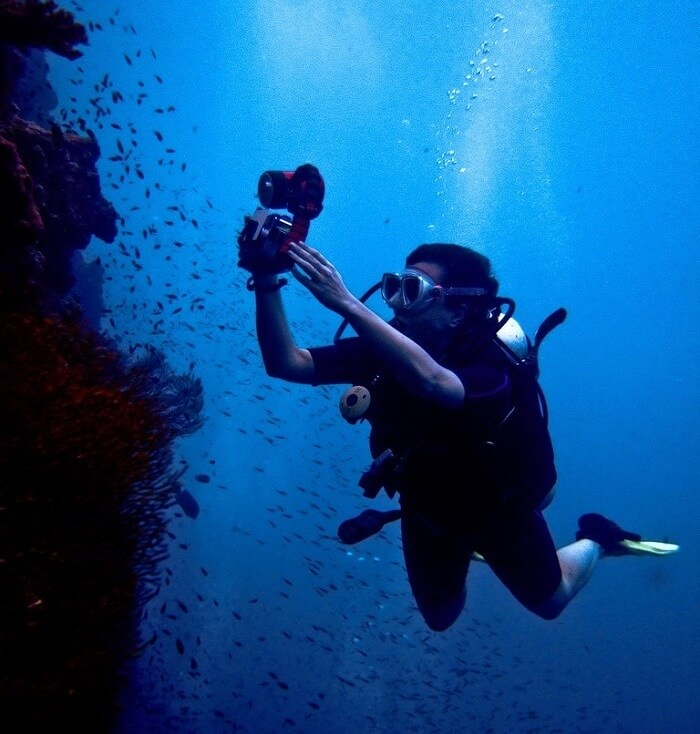 Man clicking picture while diving