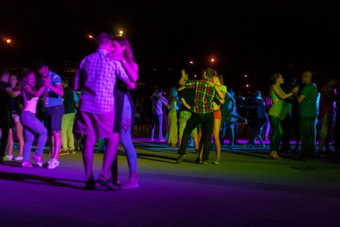 Couples enjoying salsa dance at a club