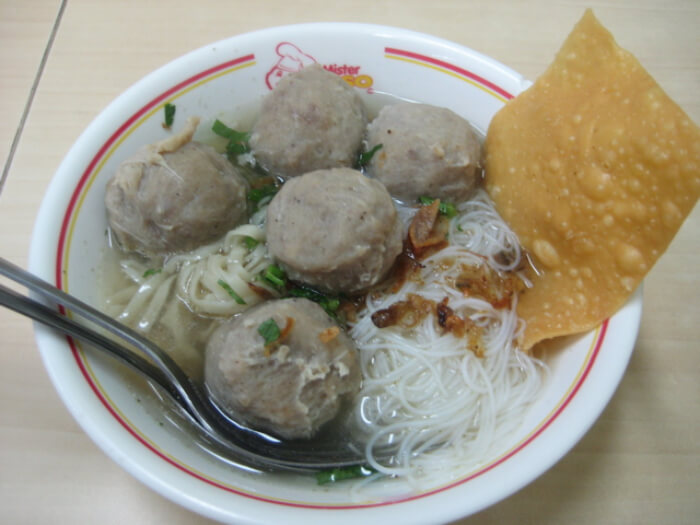 served with yellow noodles and rice vermicelli
