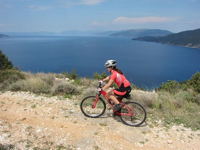 woman riding a bike across the island