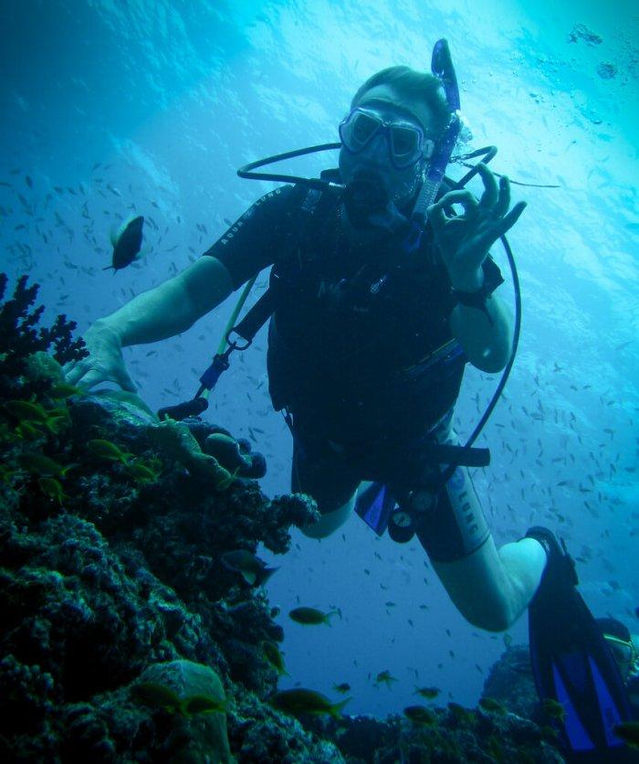 man enjoying diving in phi phi islands