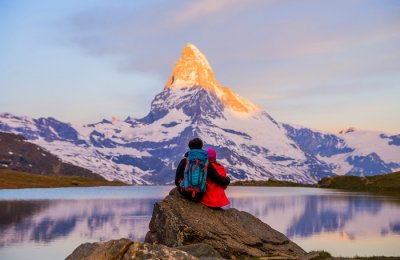 couple admiring Swiss Alps
