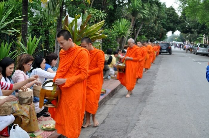practice of offering goods to the Buddhist monks