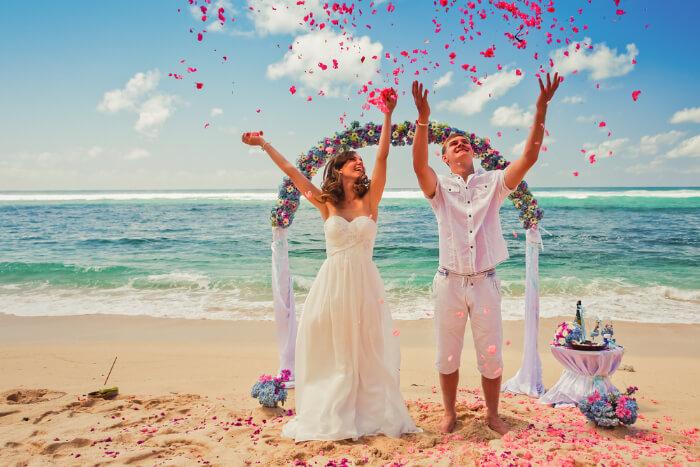 A couple at their beach wedding