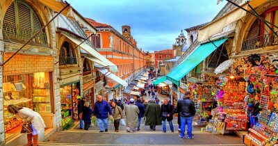 people shopping in famous place in italy