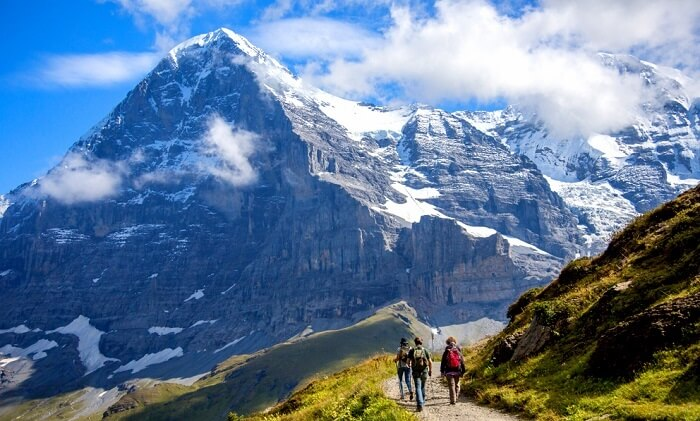 people hiking on a famous trail in switzerland