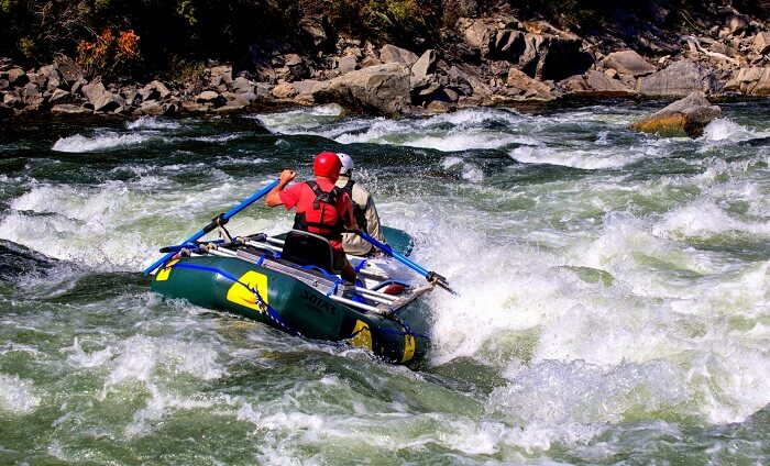 a man in water rafting