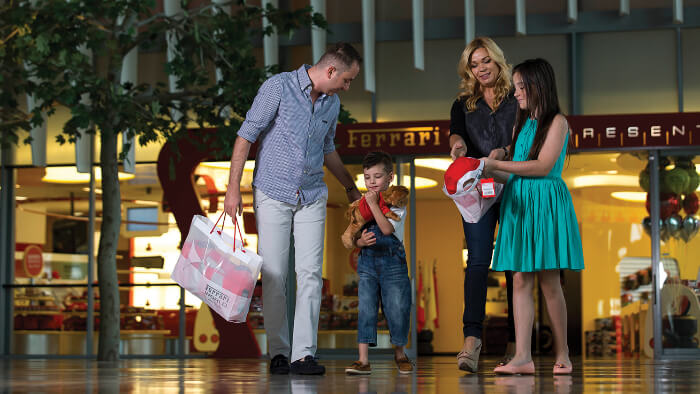 A family enjoying shopping at Ferrari World