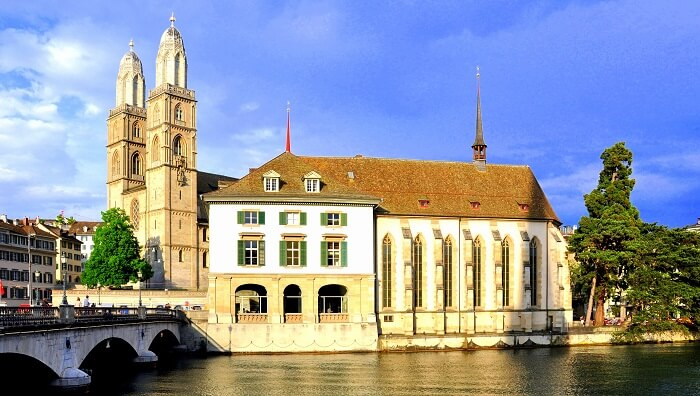 church by the river in Switzerland city
