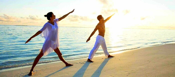 morning yoga session couple