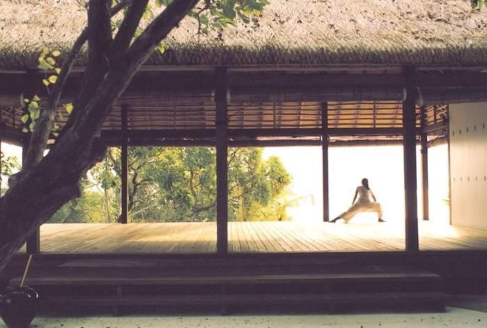 girl doing yoga in resort