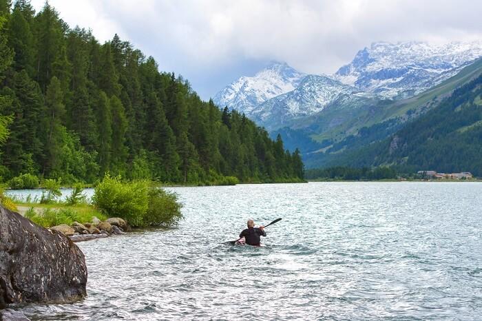 man kayaking in the river in switzerland