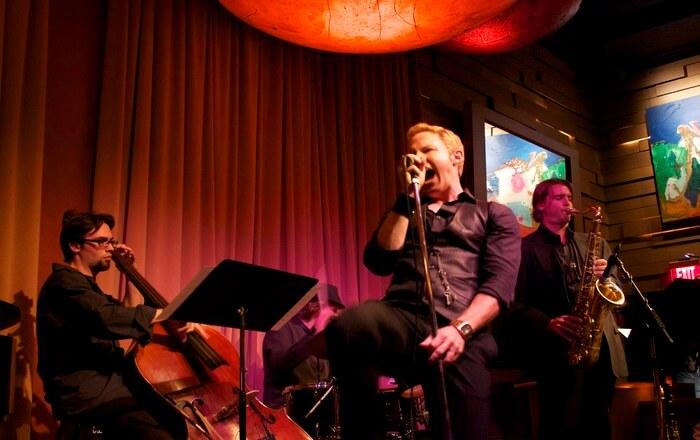 Boy singing in bar