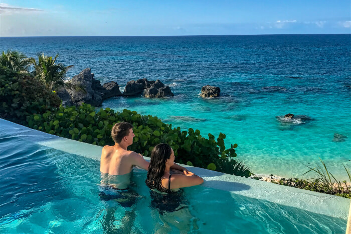 couple in a swimming pool with a view