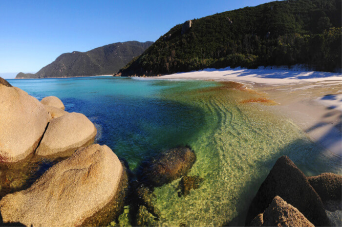 soft-sand beaches, soaring mountains, dramatic cliffs