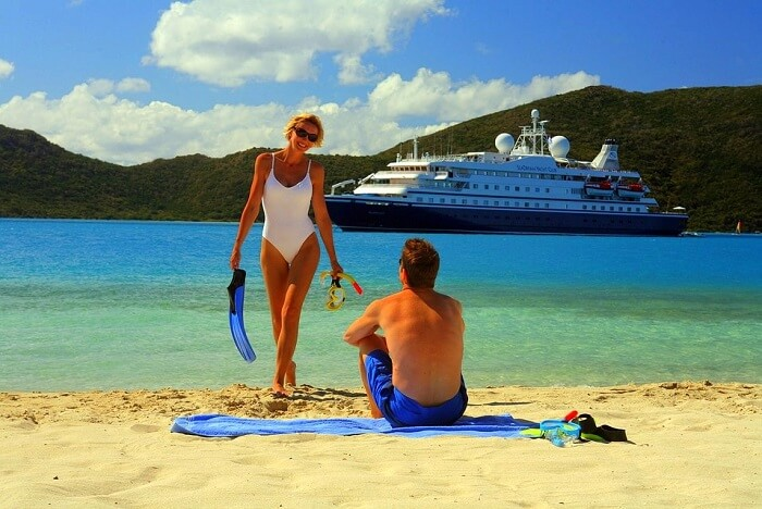 Man and women on beach enjoying