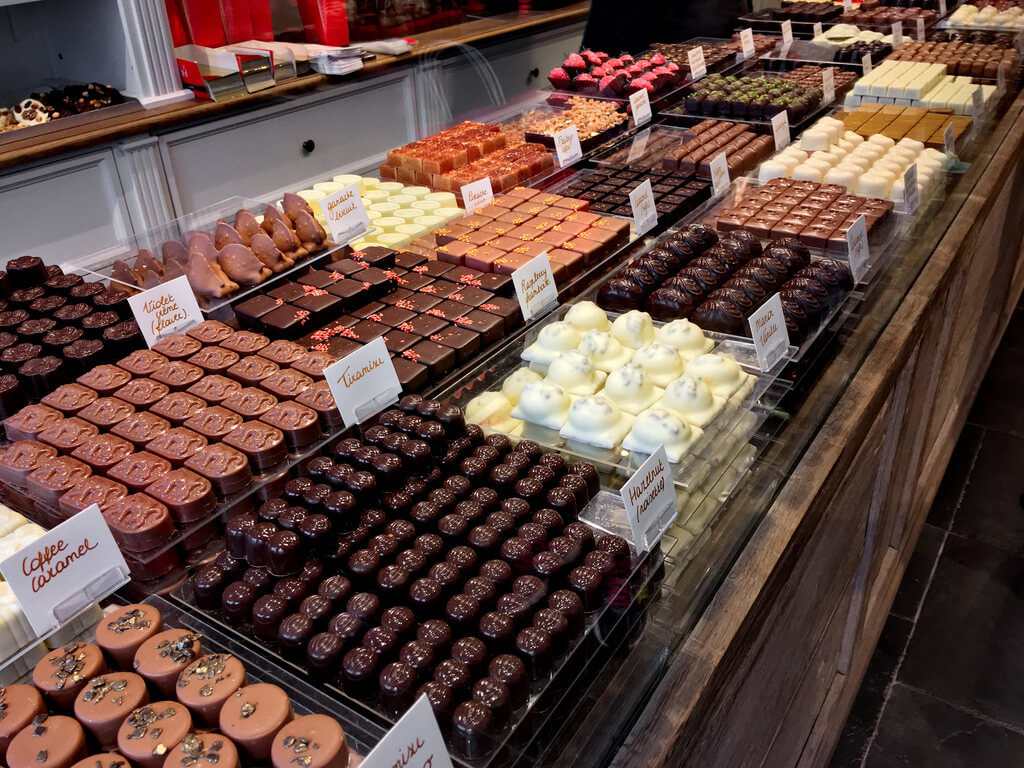 chocolates kept in glass shelves in a chocolate shop