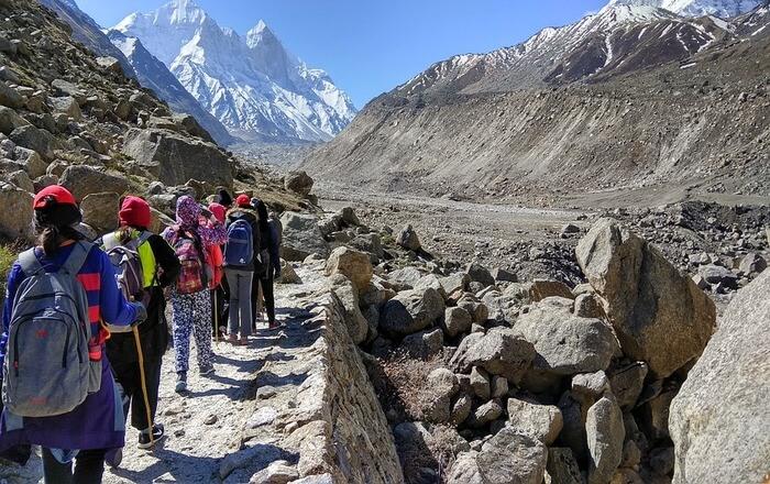 People walking on rocky road